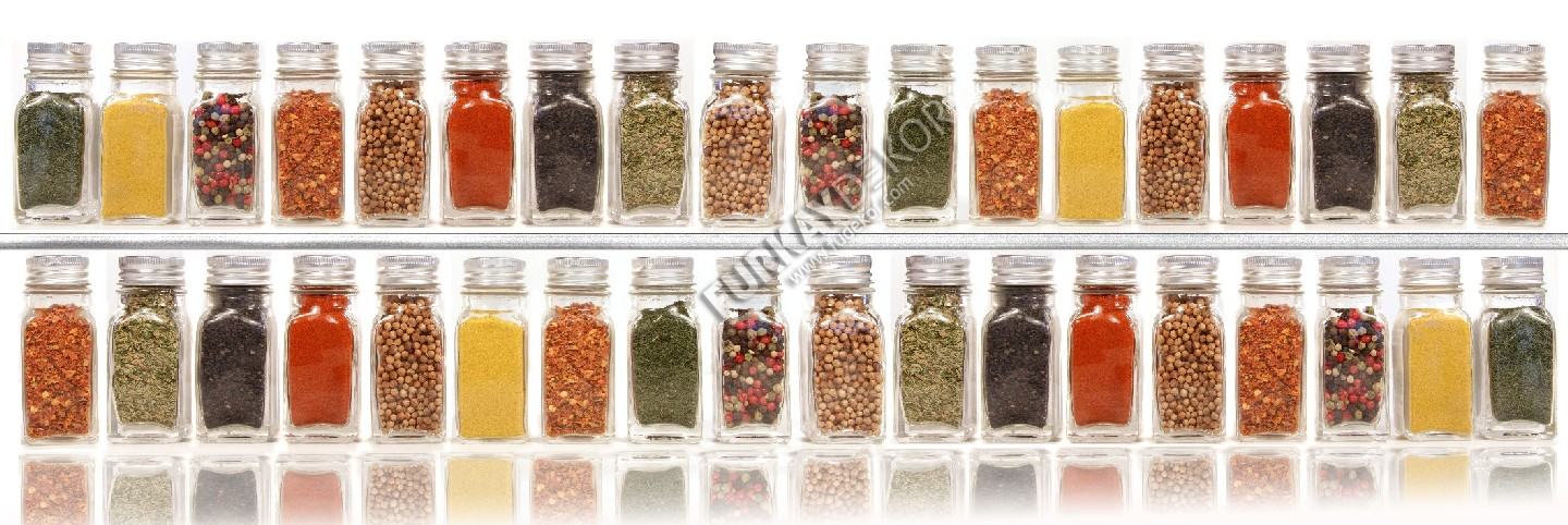 Assorted spices on two layer shelves against white background